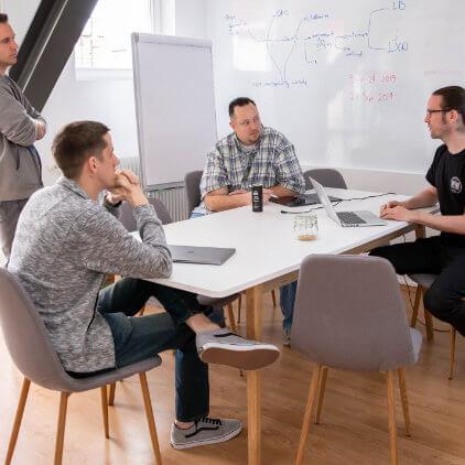 Kinsta team working meeting at the Kinsta office