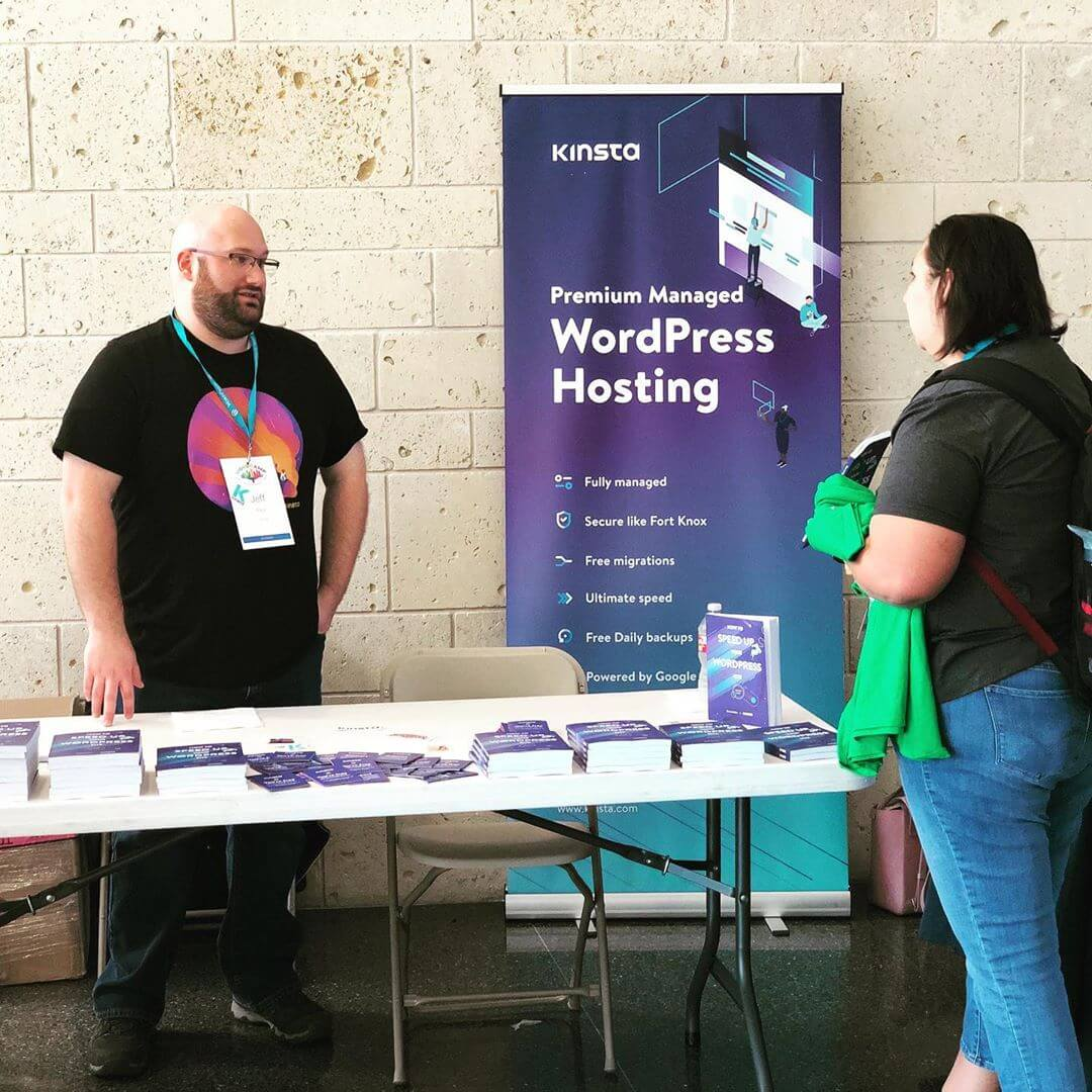 The Kinsta booth at WordCamp Dallas