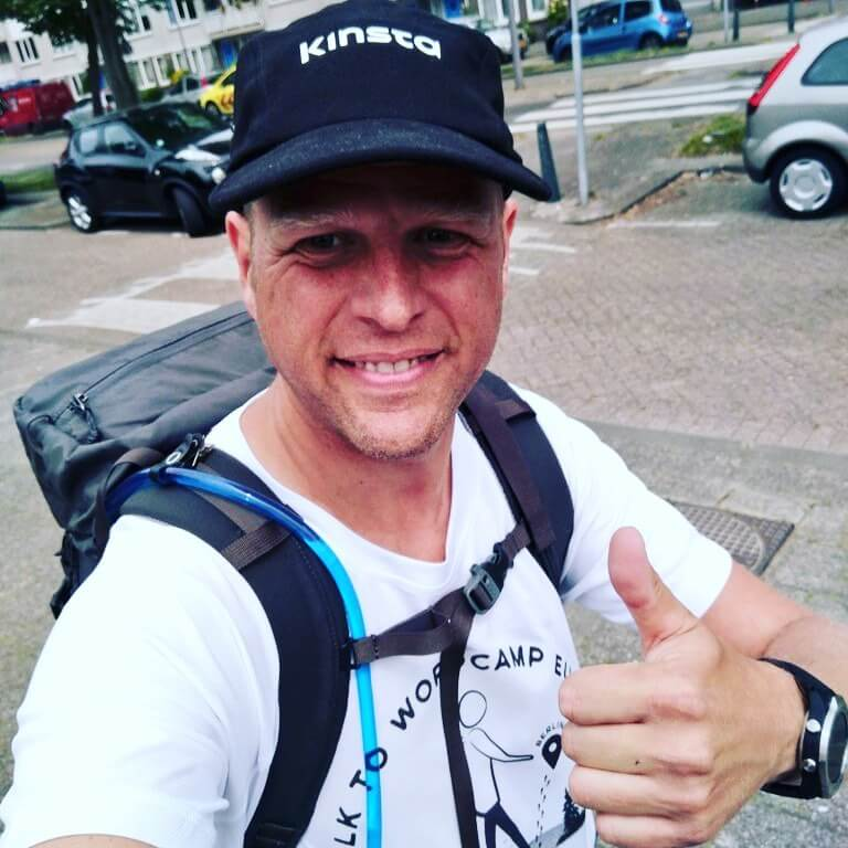A Kinsta team member walking to WordCamp Europe